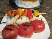 Grill some onions and tomatoes to serve with the kababs (optional).